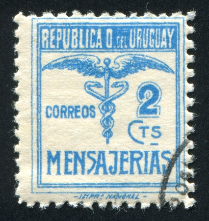 URUGUAY - CIRCA 1922: stamp printed by Uruguay, shows Caduceus, circa 1922 Stock Photo - 14171551