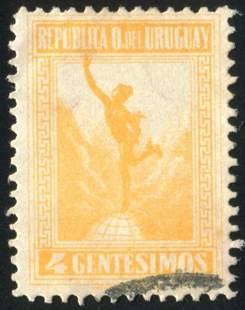mercury staff: URUGUAY - CIRCA 1922: stamp printed by Uruguay, shows Mercury, circa 1922 Stock Photo
