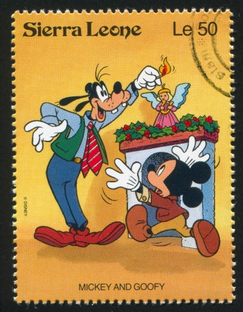 SIERRA LEONE - CIRCA 1992: stamp printed by Sierra Leone, shows Walt Disney Characters in Christmas Scenes, circa 1992.