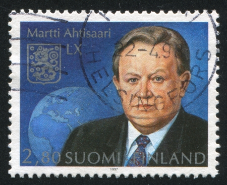 FINLAND - CIRCA 1997: stamp printed by Finland, shows President Martti Ahtisaari, circa 1997 Stock Photo - 14224364