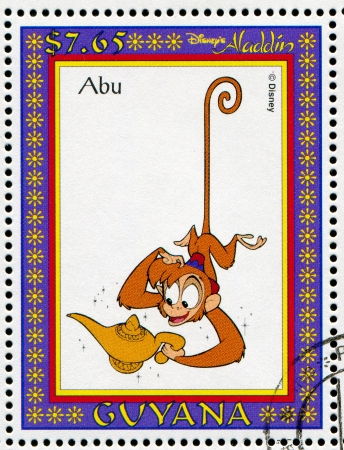 GUYANA - CIRCA 1993: stamp printed by GUYANA, shows Aladdin, Disney animated film, Abu, circa 1993