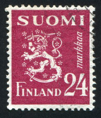 FINLAND - CIRCA 1930: stamp printed by Finland, shows Coat of arms of Finland, circa 1930 photo
