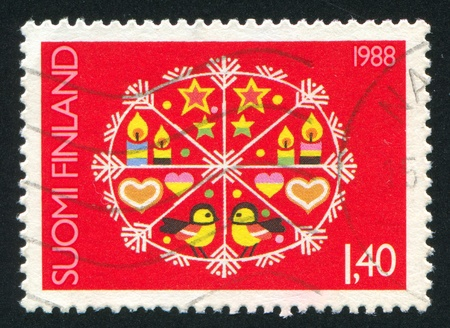 FINLAND - CIRCA 1988: stamp printed by Finland, shows Snow crystal with Christmas symbols, circa 1988 photo