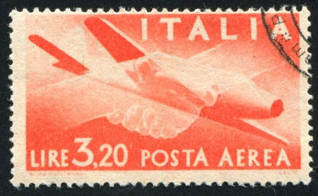 ITALY - CIRCA 1945: stamp printed by Italy, shows Plane and Clasped Hands, circa 1945 photo