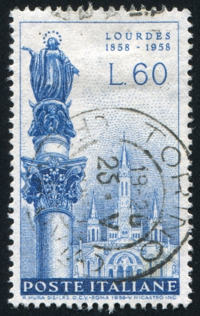ITALY - CIRCA 1958: stamp printed by Italy, shows Immaculate Conception Statue, Rome, and Lourdes Basilica, circa 1958 Stock Photo - 14258320