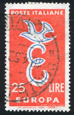 ITALY - CIRCA 1958: stamp printed by Italy, shows emblem with a bird, circa 1958 photo