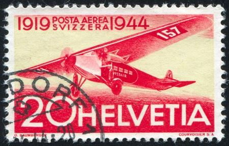SWITZERLAND - CIRCA 1944: stamp printed by Switzerland, shows Fokker, circa 1944 photo