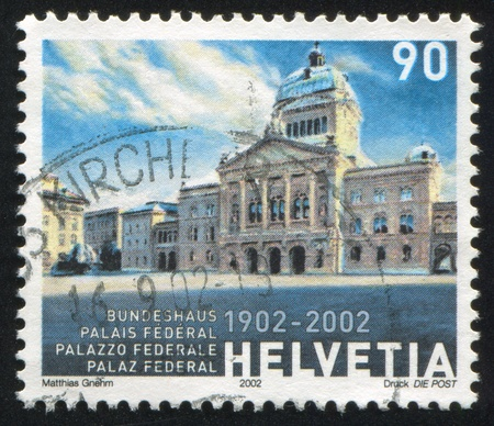 a faction: SWITZERLAND - CIRCA 2002: stamp printed by Switzerland, shows Federal Parliament Building, circa 2002