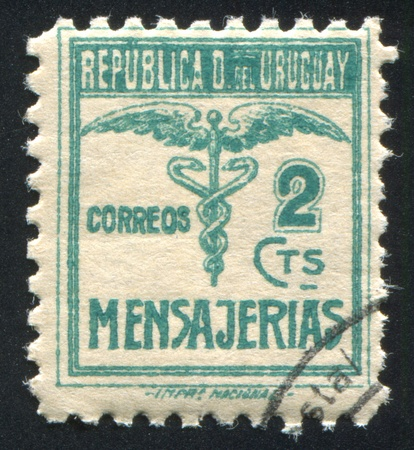 URUGUAY - CIRCA 1922: stamp printed by Uruguay, shows Caduceus, circa 1922 photo
