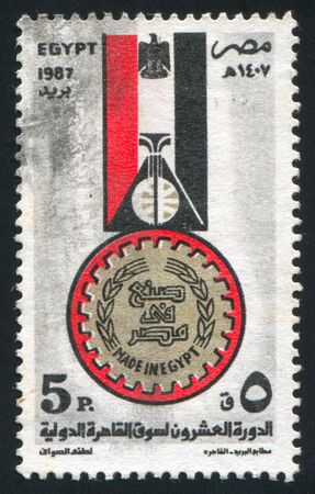 EGYPT - CIRCA 1987: stamp printed by Egypt, shows Stylized egyptian flag, Good workers medal, emblem, circa 1987