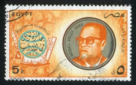 EGYPT - CIRCA 1988: stamp printed by Egypt, shows Globe, books, Naguib Mahfouz portrait, circa 1988 Stock Photo - 14277841