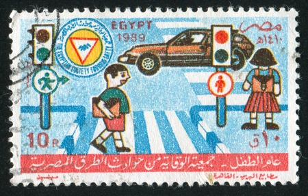 EGYPT - CIRCA 1989: stamp printed by Egypt, shows Crossroads, car, childrens, circa 1989