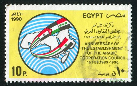 EGYPT - CIRCA 1990: stamp printed by Egypt, shows Globe, National Flags, Map of North Africa, circa 1990