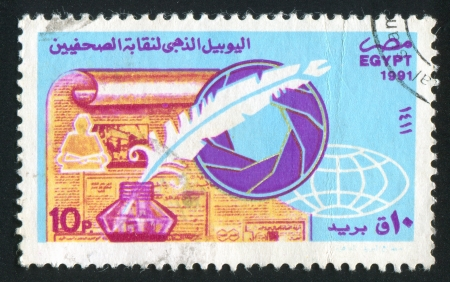 EGYPT - CIRCA 1991: stamp printed by Egypt, shows Newspaper, inkwell with feather, globe, circa 1991