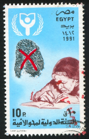 EGYPT - CIRCA 1991: stamp printed by Egypt, shows Emblem, Mature woman, circa 1991