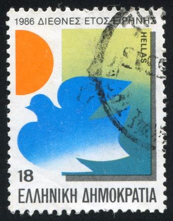 GREECE - CIRCA 1986: stamp printed by Greece, shows Dove, sun, circa 1986