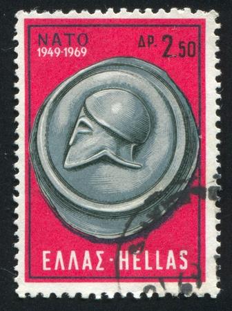 north atlantic treaty organization: GREECE - CIRCA 1969 stamp printed by Greece, shows Attic Shield and Greek Helmet, circa 1969