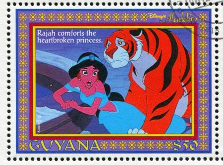 rajah: GUYANA - CIRCA 1993: sello impreso por Guyana, muestra de Aladdin, la pel�cula animada de Disney, Rajah y Jasmine, alrededor del a�o 1993