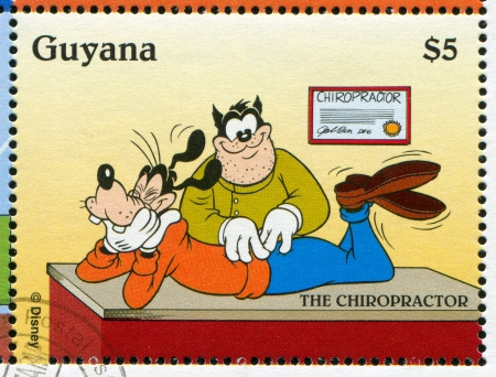 medico: GUYANA - CIRCA 1995: stamp printed by Guyana, shows Walt Disney characters, Goofy, Chiropractor, circa 1995 Editorial