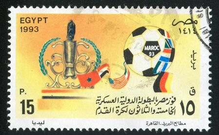 EGYPT - CIRCA 1993: stamp printed by Egypt, shows Soccer ball, Trophy, National flags, circa 1993