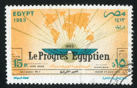 EGYPT - CIRCA 1993: stamp printed by Egypt, shows World map, wings, rays, inscription, circa 1993