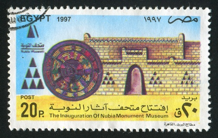 abjad: EGYPT - CIRCA 1997: stamp printed by Egypt, shows Fortress, shield, signs, circa 1997 Editorial