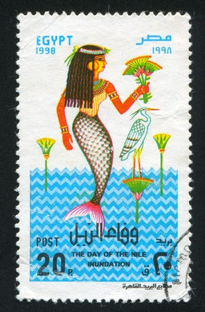 EGYPT - CIRCA 1998: stamp printed by Egypt, shows Mermaid, Heron, water, circa 1998