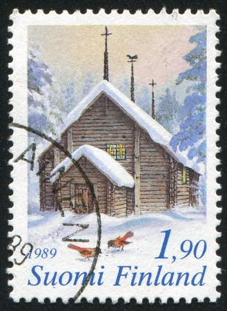 FINLAND - CIRCA 1989: stamp printed by Finland, shows Wooden Church in Lapland, circa 1989