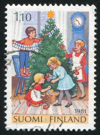 FINLAND - CIRCA 1981: stamp printed by Finland, shows Children Decorating Christmas Tree, circa 1981