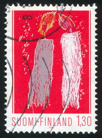 FINLAND - CIRCA 1983: stamp printed by Finland, shows Child Drawing, Christmas Candles, circa 1983