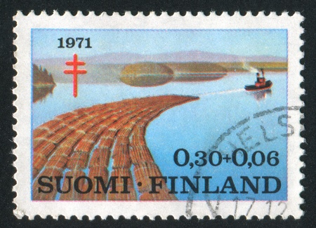 FINLAND - CIRCA 1971: stamp printed by Finland, shows Wood Transport Floating on the Water, circa 1971