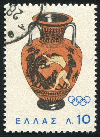 GREECE - CIRCA 1964: stamp printed by Greece, shows Peleus and Atlante fighting, circa 1964 Stock Photo - 14444170