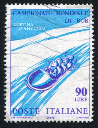 to steer a sledge: ITALY - CIRCA 1966: stamp printed by Italy, shows Four-man bobsled, circa 1966