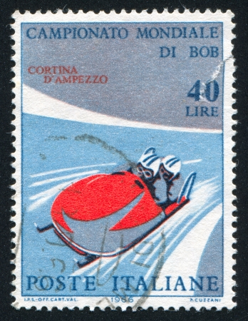 to steer a sledge: ITALY - CIRCA 1966: stamp printed by Italy, shows Two-man bobsled, circa 1966 Editorial