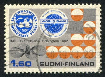 FINLAND - CIRCA 1982: stamp printed by Finland, shows Badges of the IMF and World Bank, circa 1982