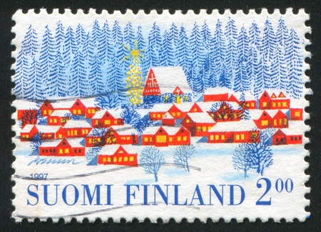 FINLAND - CIRCA 1997: stamp printed by Finland, shows Village in Winter, circa 1997 Stock Photo - 14466621