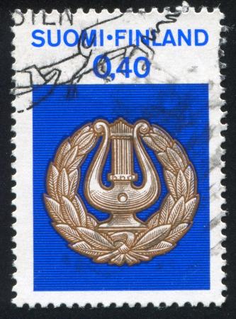 resonator: FINLAND - CIRCA 1968: stamp printed by Finland, shows Student Harp inside Laurels, circa 1968