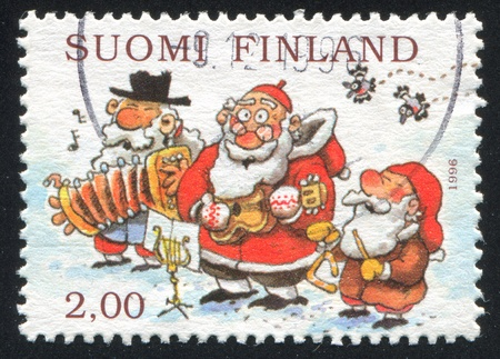 FINLAND - CIRCA 1996: stamp printed by Finland, shows Snowman, Santa and Gnome Playing Musical Instruments, circa 1996
