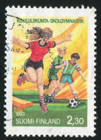 FINLAND - CIRCA 1993: stamp printed by Finland, shows Schoolchildren sporting, circa 1993