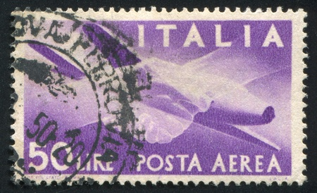 ITALY - CIRCA 1945: stamp printed by Italy, shows Plane and Clasped Hands, circa 1945