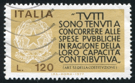 ITALY - CIRCA 1977: stamp printed by Italy, shows  Coat of arms of Italian Republic and Italian Constitution, Article 53, circa 1977
