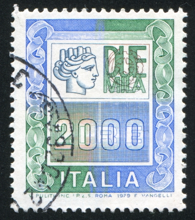 "ITALY - CIRCA 1977: stamp printed by Italy, shows head of a woman, who symbolize ""Italia"", circa 1977"