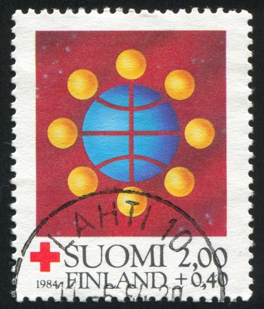 FINLAND - CIRCA 1984: stamp printed by Finland, shows Symbolic world communication, circa 1984 Stock Photo - 14564956