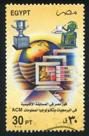 abjad: EGYPT - CIRCA 2004: stamp printed by Egypt, shows Monitors, Cup, pharaoh, globe, circa 2004
