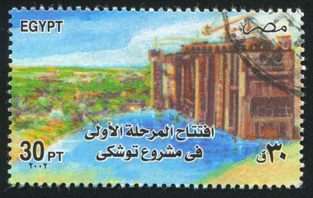 abjad: EGYPT - CIRCA 2002: stamp printed by Egypt, shows Dam Construction, circa 2002 Editorial