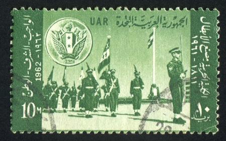 abjad: EGYPT - CIRCA 1962: stamp printed by Egypt, shows Military parade, circa 1962 Editorial