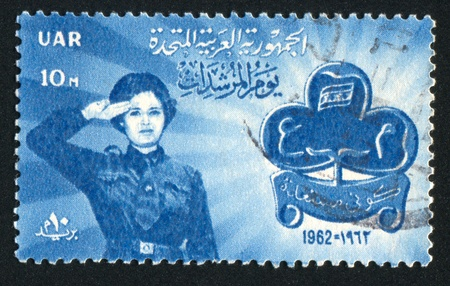EGYPT - CIRCA 1962: stamp printed by Egypt, shows Girl Scout Saluting, Emblem, circa 1962