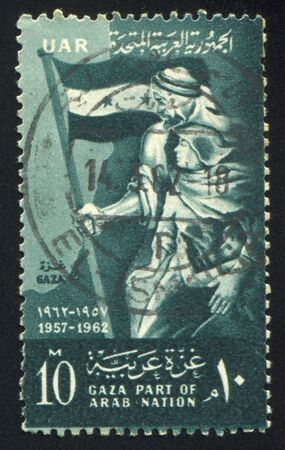 yashmak: EGYPT - CIRCA 1962: stamp printed by Egypt, shows Man with flag, woman, children, circa 1962