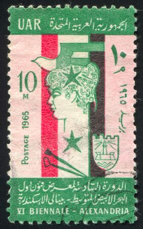EGYPT - CIRCA 1965: stamp printed by Egypt, shows Face, Flag, emblem, circa 1965