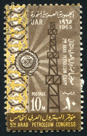 EGYPT - CIRCA 1965: stamp printed by Egypt, shows Oil derrick, emblem, ornament, circa 1965